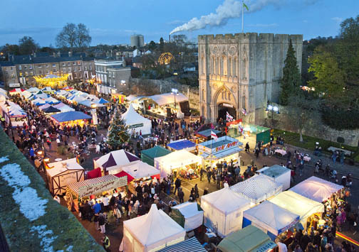 A birds eye view of lots of market stalls at dusk on Angel Hill