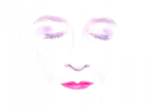 An impression of a ladies face with pink lipstick and eyes shut