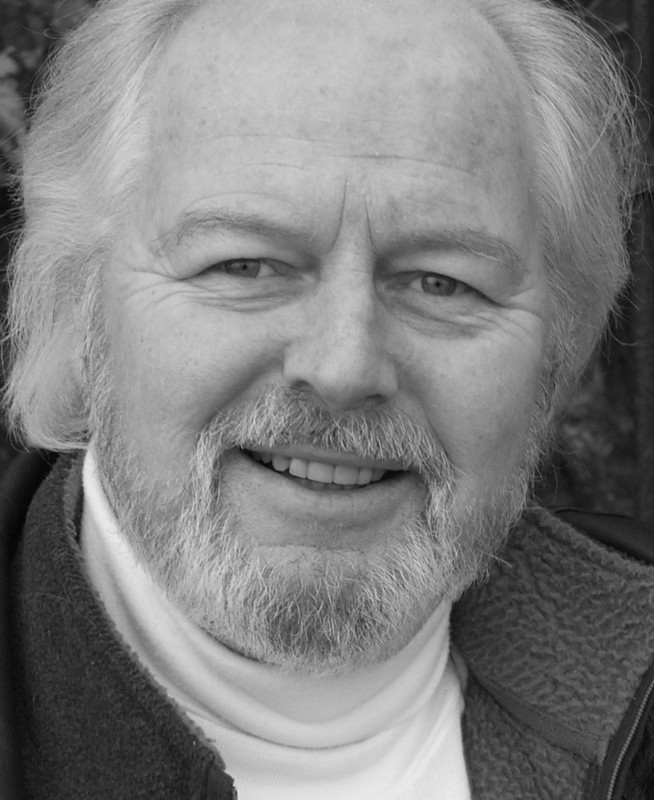 A Black and White headshot of Ian Lavender