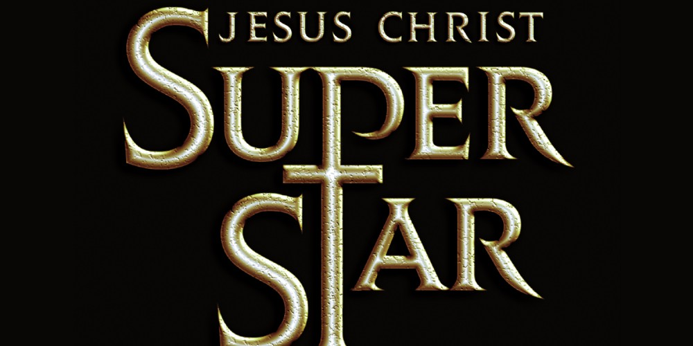 A black background with Gold text stating Jesus Christ Superstar