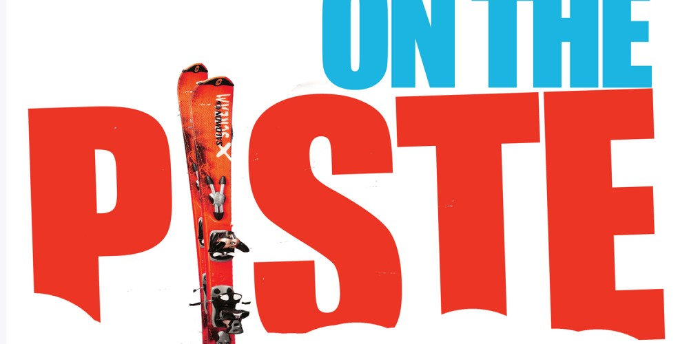 Blue and Red lettering stating On The Piste with Ski's replacing the I in piste