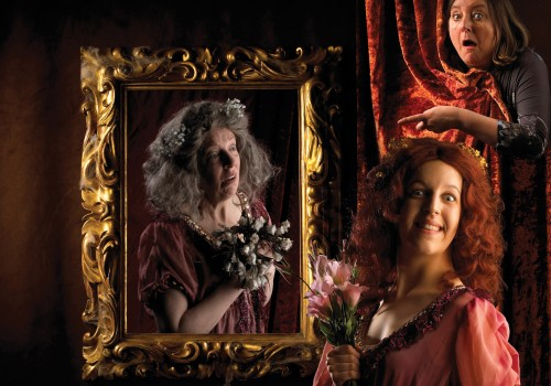 A golden mirror frame with an old lady holding a bunch of dying flowers and a younger lady with ginger hair stood in front holding a bunch of pink flowers