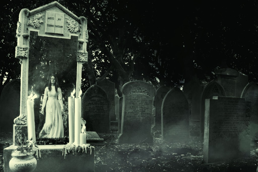 The Mist in the Mirror promotional image - graveyard at night